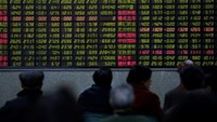 Investors look at an electronic board showing stock information at a brokerage house in Shanghai, China, January 14, 2016.