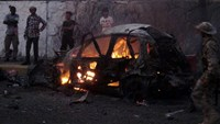 A car burns at the site of a car bomb attack outside the house of the director of security for Yemen's southern port city of Aden Brigadier General Shalal Ali Shayyeh in Aden January 17, 2016.