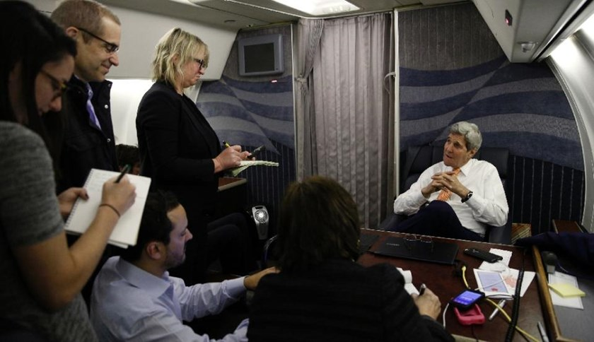 US Secretary of State John Kerry speaks to journalists about his negotiations with Iran upon his arrival from Vienna at Joint Base Andrews on January 17, 2016