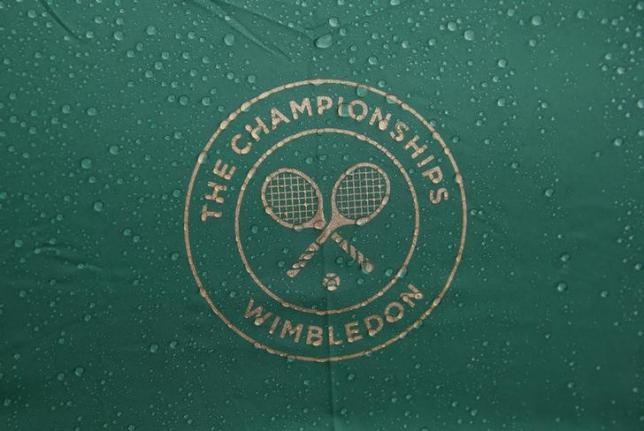 Raindrops are seen on an umbrella at the Wimbledon Tennis Championships, in London in this file photo dated June 30, 2014.