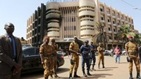 Soldiers stand guard in front of the Splendid Hotel after an attack on the hotel and a restaurant in Ouagadougou, Burkina Faso, January 18, 2016.