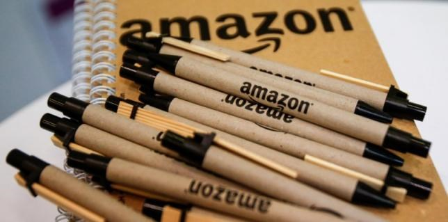 Pens and paper with the Amazon logo are seen at the logistics center in Brieselang, Germany November 17, 2015.