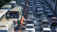"A major thoroughfare is clogged with traffic in Manila, a problem dubbed ""carmaggedon"" by locals"