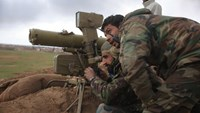 Syrian pro-government forces adjust a man-portable anti-tank system (MANPAT) as they hold a position in the Hatabat al-Bab area, on January 24, 2016, during a military operation against Islamic State (IS) group jihadists