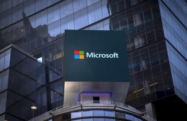 The Microsoft logo is seen on an electronic billboard on an office building in New York City, July 28, 2015.