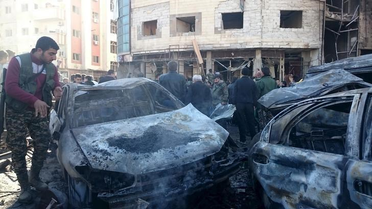 Residents and soldiers loyal to Syria's President Bashar al-Assad inspect damage after a suicide attack in Sayeda Zeinab, a district of southern Damascus, Syria January 31, 2016.