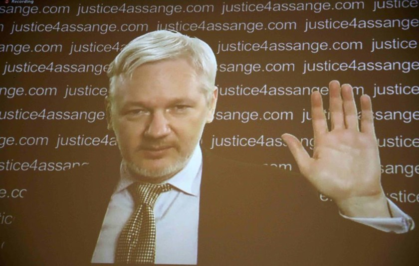WikiLeaks founder Julian Assange appears on screen via video link during a news conference at the Frontline Club in London, Britain February 5, 2016.
