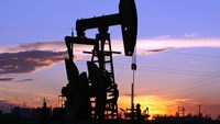 An oil pump is seen at sunset in an oilfield outside Daqing, Heilongjiang province, China.
