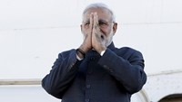 India's Prime Minister Narendra Modi gestures while disembarking his plane after arriving at the Ottawa International Airport in this April 14, 2015 file photo.