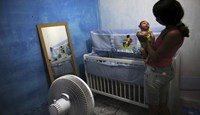 Daniele Santos holds her son Juan Pedro who is 2-months old and born with microcephaly at their house in Recife.