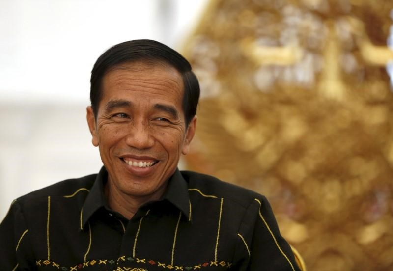Indonesian President Joko Widodo smiles during an interview with Reuters at the presidential palace in Jakarta, Indonesia February 10, 2016.