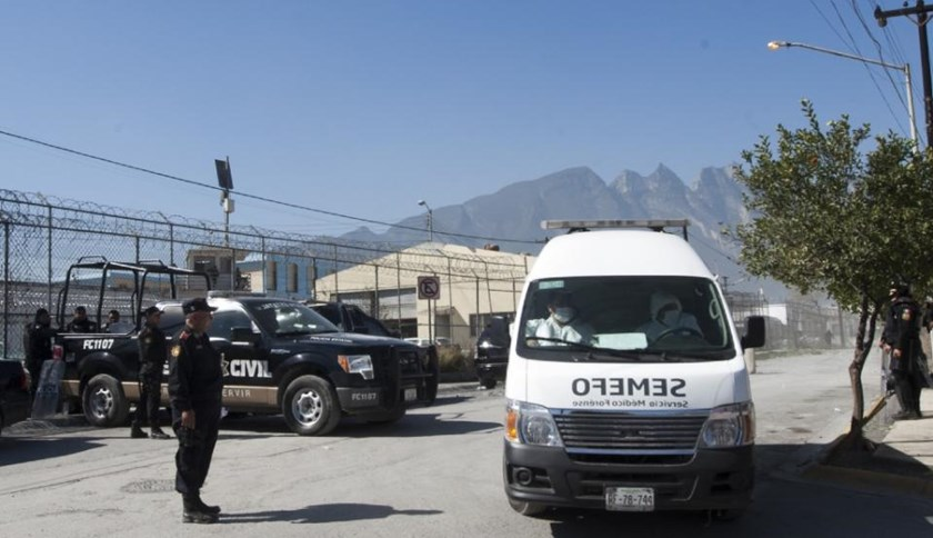 An ambulance leaves Topo Chico prison in Monterrey, Mexico on February 11, 2016 after a riot killed 49 inmates