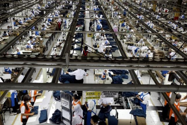 An aerial view of workers at PT Trisula Garmindo Manufacturing in Bandung, West Java province, in this September 17, 2013 file photo.
