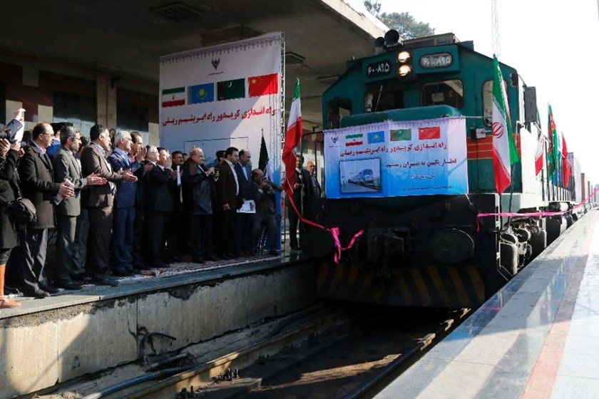 Iranian officials applaud on the platform as the first train connecting China and Iran arrives at Tehran Railway Station on February 15, 2016