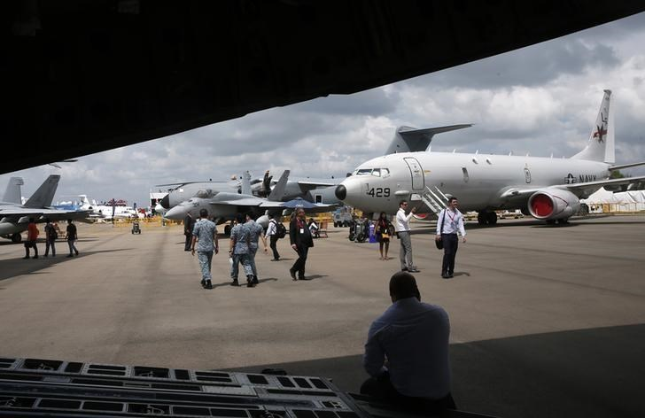 U.S. Air Force Boeing P-8 Poseidon (R) is displayed at the Singapore Airshow at Changi Exhibition Center February 18, 2016.