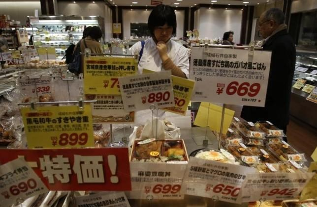 A shopper looks at food at a supermarket in Tokyo February 26, 2015.