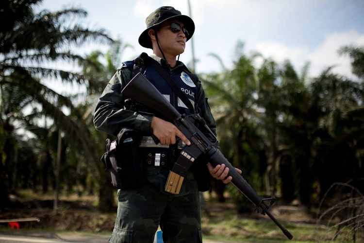 An armed Malaysian policemen mans a security checkpoint in a 2013 file photo