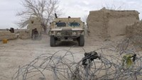 An Afghan National Army (ANA) vehicle is seen parked at an outpost in Helmand province, Afghanistan December 25, 2015.
