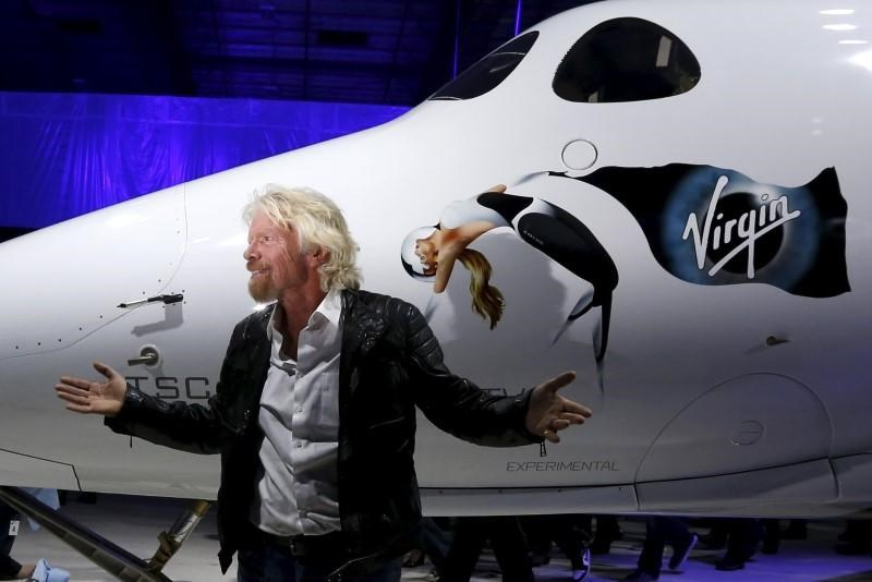 Richard Branson poses after unveiling the new SpaceShipTwo, a six-passenger two-pilot vehicle meant to ferry people into space that replaces a rocket destroyed during a test flight in October 2014, in Mojave, California, United States, February 19, 2016.