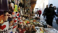 Souvenir mugs featuring Syria's President Bashar al-Assad, Russia's President Vladimir Putin and Lebanon's Hezbollah leader Sayyed Hassan Nasrallah are seen among other items for sale in old Damascus, Syria, February 8, 2016.