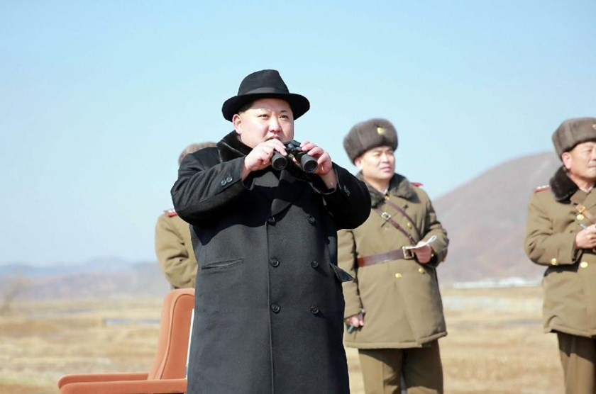 North Korean leader Kim Jong-Un (C) inspects a drill of fighter pilots from the Korean People's Army Air Force at an undisclosed location on February 21, 2016