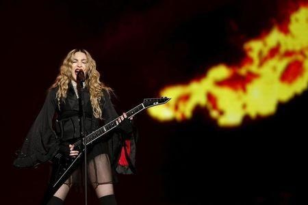 Singer Madonna performs during her concert at the AccorHotels Arena in Paris.