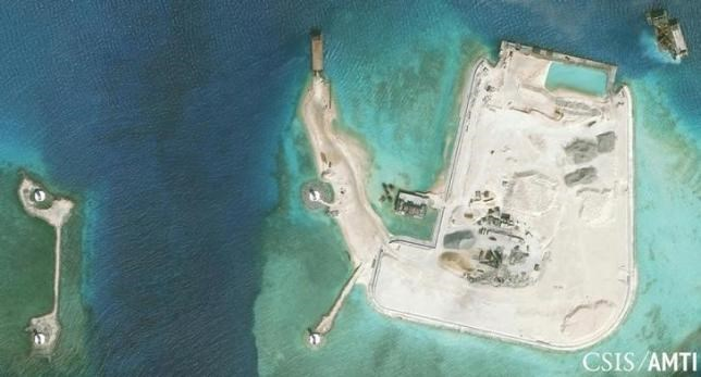 The artificial island at the southern end of Mischief Reef showing a newly-built seawall on its north side and a completed dock are shown in this Center for Strategic and International Studies (CSIS) Asia Maritime Transparency Initiative January 8, 2016 satellite image