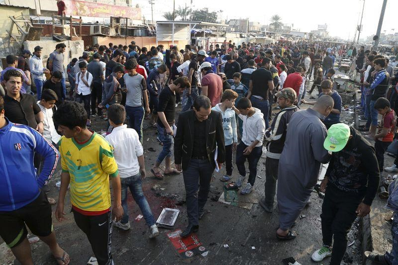 People gather at the site of suicide blasts in Baghdad's Sadr City February 28, 2016.