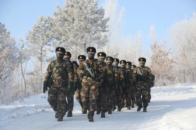 Soldiers of China's People's Liberation Army (PLA) take part in training in temperatures below minus 30 degrees Celsius (minus 22 degrees Fahrenheit) at China's border with Russia in Fuyuan, Heilongjiang province, January 14, 2016.
