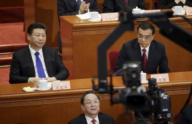 China's President Xi Jinping (L), Premier Li Keqiang (R) and Yu Zhengsheng, chairman of the National Committee of the Chinese People's Political Consultative Conference (CPPCC), attend the opening session of the CPPCC at the Great Hall of the People in Beijing, China, March 3, 2016.