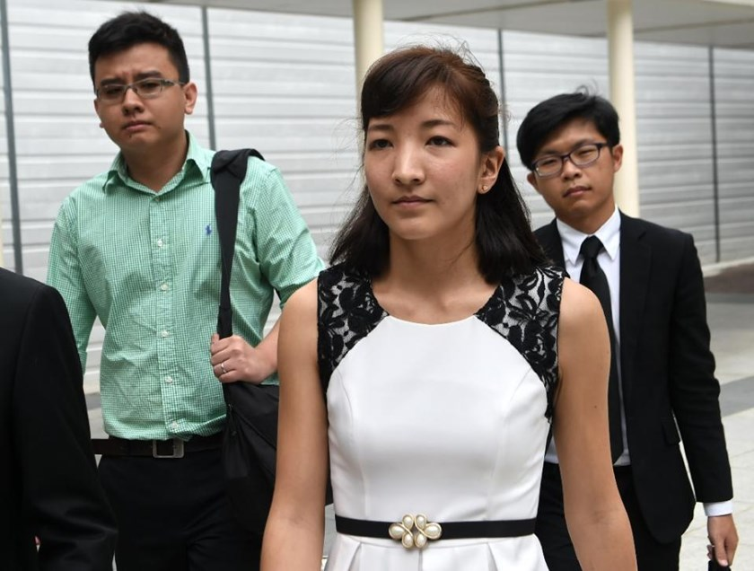 "Australian Japanese Ai Takagi (front) and her Singaporean husband Yang Kaiheng (left), each face 7 sedition charges for articles published between October 2013 and February 2015 on the socio-political website ""The Real Singapore"""
