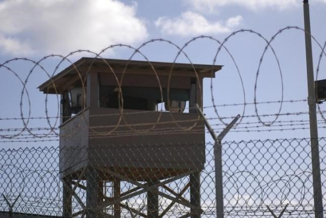 A soldier stands guard in a tower overlooking Camp Delta at Guantanamo Bay naval base in a December 31, 2009 file photo provided by the US Navy.