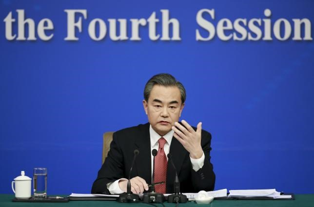 China's Foreign Minister Wang Yi gestures as he speaks during a news conference on the sidelines of the National People's Congress, in Beijing, China, March 8, 2016.