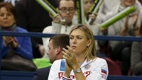 Russia's Maria Sharapova reacts as she watches compatriot Ekaterina Makarova play against Kiki Bertens of the Netherlands during their Fed Cup World Group tennis match in Moscow, February 6, 2016.