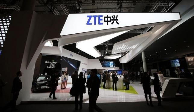 Visitors check out products at the ZTE stand at the Mobile World Congress in Barcelona, February 24, 2014.