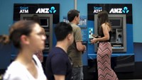 Australia and New Zealand Banking Group Ltd (ANZ) customers use their automatic teller machines (ATMs) at a branch in Sydney, February 16, 2016.