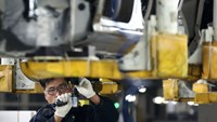 A worker assembles a Beijing Hyundai Motor Co. car on the production line at the company's plant in Beijing, China.