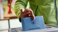 A woman casts her vote during regional elections at a polling station in Bad Kreuznach, in the German federal state of Rhineland-Palatinate, March 13, 2016.