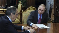Russian President Vladimir Putin meets Foreign Minister Sergei Lavrov at the Kremlin in Moscow, Russia, March 14, 2016.