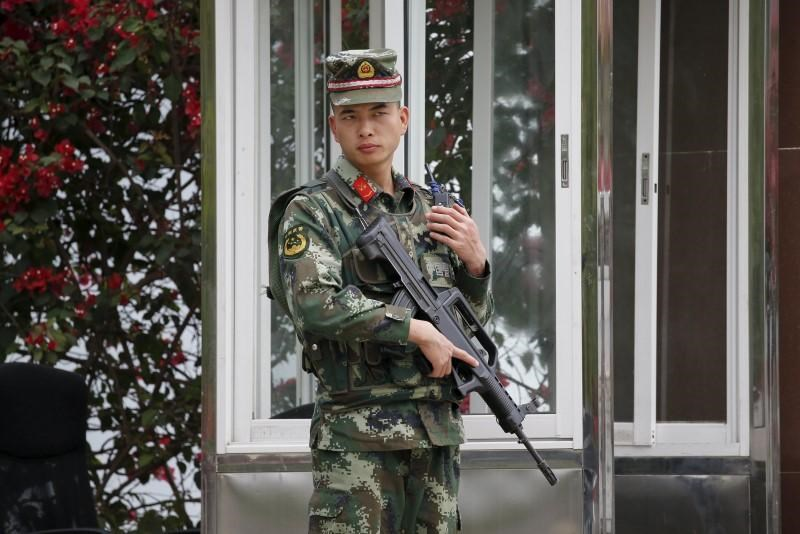 A Chinese paramilitary policeman guards a base at the Mekong river port of Mouang Mom on the Laos side of the Golden Triangle, near the border between Laos, Myanmar and Thailand March 2, 2016.