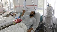A wounded Afghan man, who survived a U.S. air strike on a Medecins Sans Frontieres (MSF) hospital in Kunduz, receives treatment at the Emergency Hospital in Kabul October 8, 2015.
