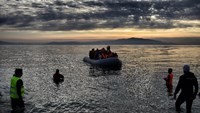 Refugees and migrants arrive on the northern island of Lesbos after crossing the Aegean sea from Turkey, on February 23, 2016