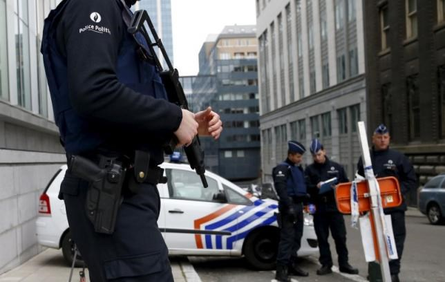 Belgian police officers secure an access to the federal police headquarters in Brussels, March 19, 2016, after Salah Abdeslam, the most-wanted fugitive from November's Paris attacks, was arrested after a shootout with police in Brussels on Friday.