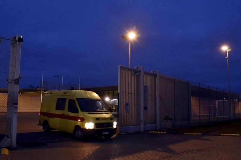 An ambulence leaves a prison in Bruges where Salah Abdeslam is being held, Belgium, March 19, 2016.