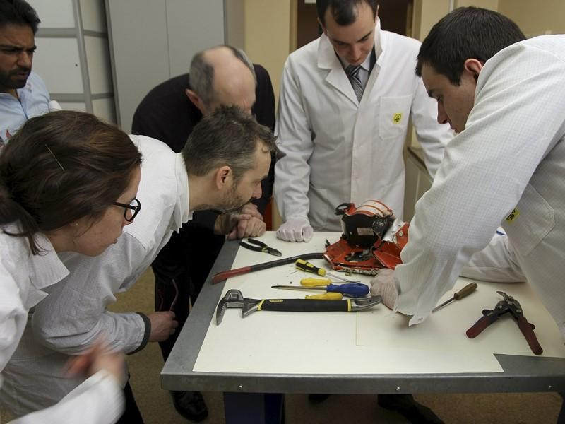 Aviation experts inspect the flight recorder from the crashed Boeing 737-800 Flight FZ981 operated by Dubai-based budget carrier Flydubai, in Moscow, Russia, in this handout image released by the Russia's Interstate Aviation Committee on March 20, 2016.