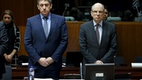 Belgian Interior Minister Jan Jambon and Justice Minister Koen Geens (R) observe a minute of silence to victims of Tuesday's bombings during an extraordinary meeting of European Union interior and justice ministers in Brussels, Belgium, March 24, 2016.