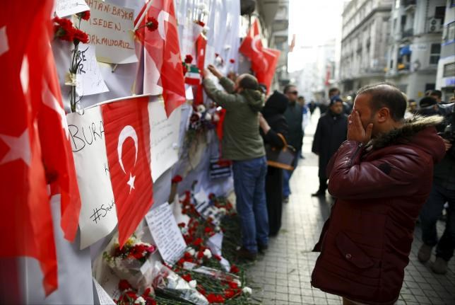 A man prays at the scene of a suicide bombing at Istiklal street, a major shopping and tourist district, in central Istanbul, Turkey March 20, 2016.