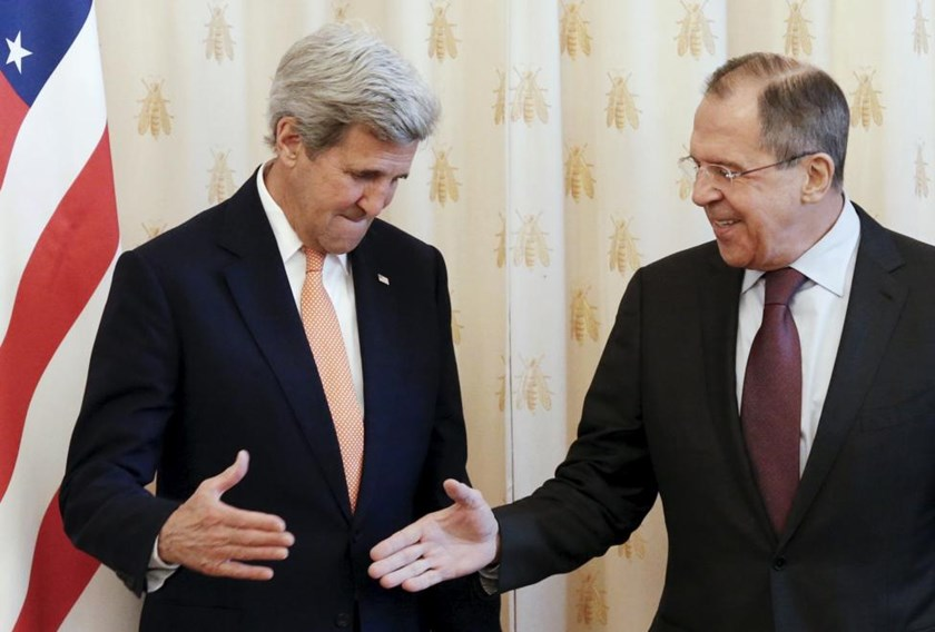 Russian Foreign Minister Sergei Lavrov (R) shakes hands with U.S. Secretary of State John Kerry during a meeting in Moscow, Russia, March 24, 2016.