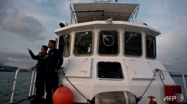 File photo: Malaysian Maritime Enforcement Agency personnel gesture during a patrol. Photo: AFP
