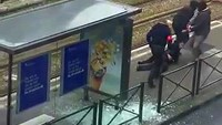 Belgian police drag a suspect along a tramway platform, in this still image taken from amateur video, after the suspect was shot, in the Brussels borough of Schaerbeek, following Tuesday's bombings in Brussels, Belgium, March 25, 2016.